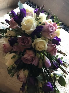 Loving the Bridal Bouquet of stunning pinks and purples