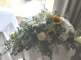 Let us craft you am eye catching sunflower arrangement for a Britol based wedding ceremony